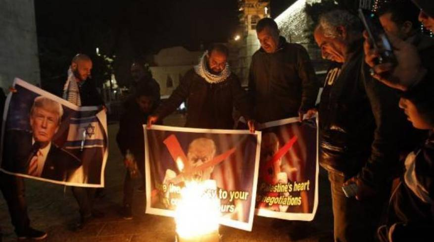 Palestinian protesters burn pictures of US president in Bethlehem. afp