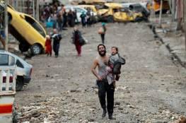 عراقيون يحفرون الآبار للحصول على المياه مع احتدام القتال في الموصل