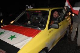 """بالفيديو والصور : أنصار النظام السوري يحتفلون بـ""""عودة حلب"""""""