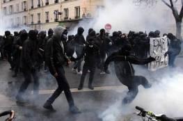 أعتقالات و حرق  بفرنسا و محتجون يشتبكون مع الشرطة بإحدى ضواحي باريس