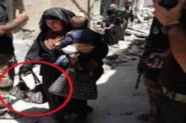 """سيدة تفجر نفسها وهي تحمل رضيعها وسط جنود عراقيين في """"الموصل"""""""