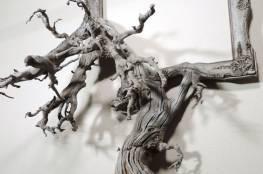 فنان يبدع بعمل براويز من جذوع الأشجار! (11 صورة)