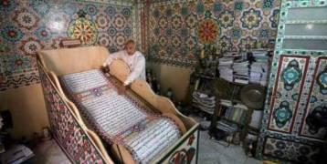 خطاط مصري يسعى لدخول جينيس بمصحف طوله ٧٠٠ متر